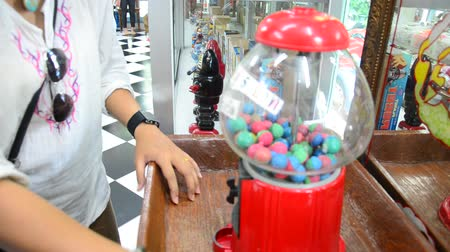 vending machine : Thai woman play Gumball machine thailand style Stock Footage