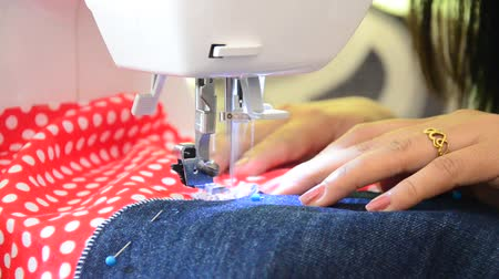 clothing : Asian women use machine sewing clothes