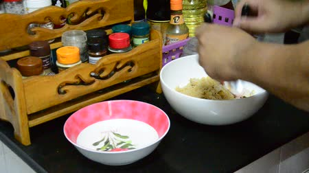 caranguejo : Cooking instant noodles mix Enokitake or golden needle mushroom with imitation crab stick mixing seasoning local thai style