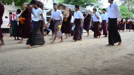 szerzetes : Monk procession walking on the road for people pray and put food offerings