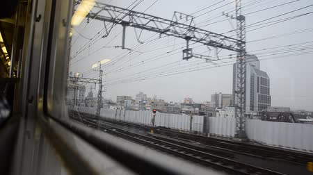shinkansen : View cityscape of Osaka on Rapid train go to Kansai Airport on July 7, 2015 in Osaka, Japan