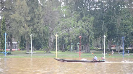 surat : Thai people driving long tail boat at Tapee river on September 20, 2015 in Surat Thani, Thailand.