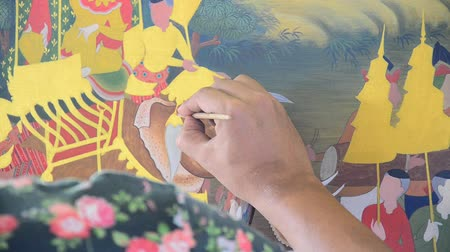 ratchaburi : Thai man filling color on picture for show and sell traveler at Wat Khanon on April 14, 2015 in Ratchaburi Thailand. Stock Footage