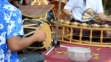 khong : Thais play traditional thai musical instruments concert show for travellers at Wat Khanon on April 14, 2015 in Ratchaburi Thailand.