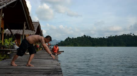 surat : Thai people play and jumping to lake water at Khao Sok National Park on March 2, 2011 in Suratthani, Thailand.
