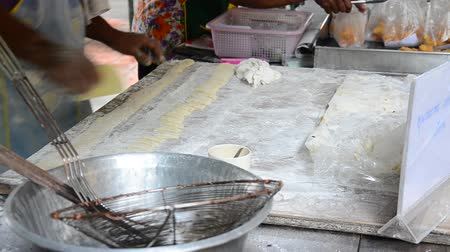 congee : Cooking deep-fried doughstick in market, Thai style food. Stock Footage