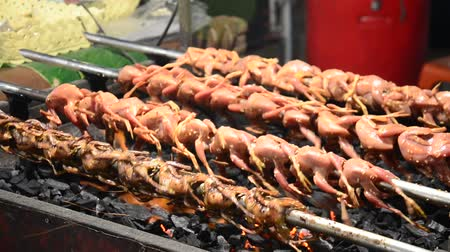 oven chicken : Grilled quail for sale people in market fair in annual festival of Wat Lam Pho in Nonthaburi, Thailand.