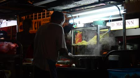 zupa : Malaysian people cooking food at Georgetown street in night time in Penang, Malaysia