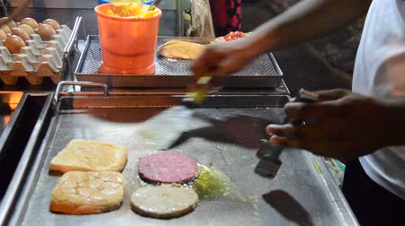 georgetown : Malaysian people cooking burger india style at Georgetown street in night time in Penang, Malaysia Stock Footage