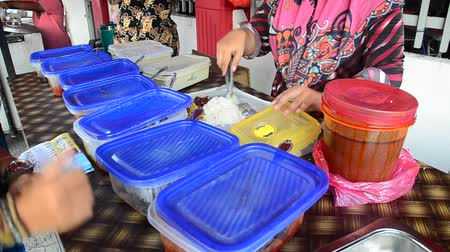 malajsky : Malaysian people sell rice topped with chili paste style at Georgetown street of Penang in Malaysia, Thailand.