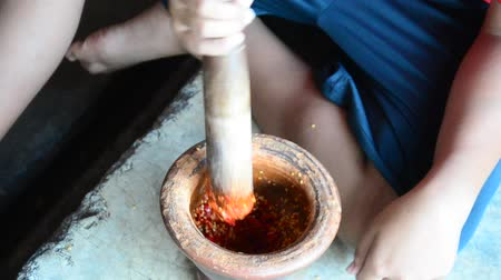 chili paprika : Thai children people pound chili and garlic for cooking Nam prik kapi a popular thai food dish