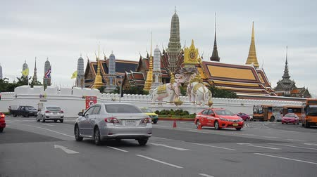 kaew : Traffic road at Wat Phra Kaew Temple of the Emerald Buddha full official name Wat Phra Si Rattana Satsadaram in Bangkok, Thailand Stock Footage