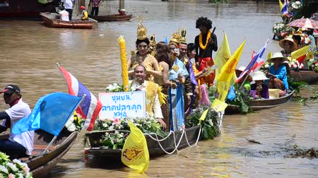 traditional ceremony : Traditional parade procession lent candle festival for Asalha Puja and Buddhist Lent Day in waterway by boat at Wat Lat Chado in Aytthaya, Thailand Stock Footage