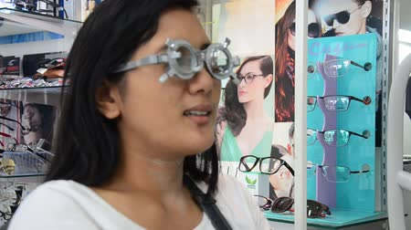 refractive : Thai woman check optical eye test  or visual acuity for making glasses by Optician Eyesight Test and Care at optical shop in Nonthaburi, Thailand