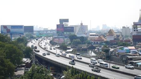 Thai people drive cars and trucks with traffic road on expressway tollway at Kluaynamthai district in Bangkok, Thailand. Stok Video