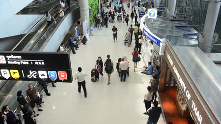 Thai people and foreigner traveller wait flight with passengers arriving and departing at Suvarnabhumi international airport in Bangkok, Thailand