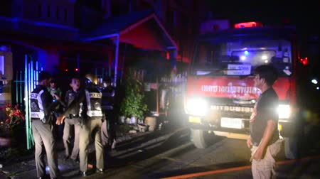 sirena : Firefighters with fire truck go to fire hydrant at house was on fire in village at night time in Nonthaburi, Thailand.