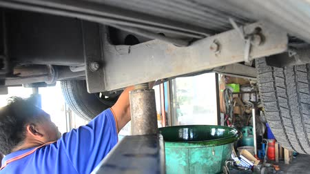 wrench : Thai mechanic people and professional automotive motor repair and maintenance change oil, Oil Filter and Check availability and prepare of car at local garage shop in Nonthaburi, Thailand