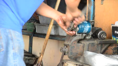 スパナ : Thai mechanic people and professional automotive motor repair and maintenance change oil, Oil Filter and Check availability and prepare of car at local garage shop in Nonthaburi, Thailand