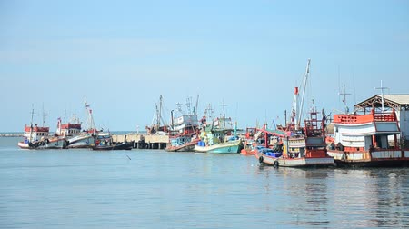 Fishing boat and ship floating in the sea for waiting fishing in night time at Ang Sila Fishing village and seafood Market in Chonburi, Thailand Stok Video