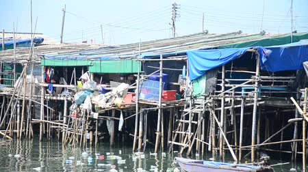 Wastewater and pollution and garbage in the sea at Ang Sila Fishing village and seafood Market in Chonburi, Thailand Stok Video