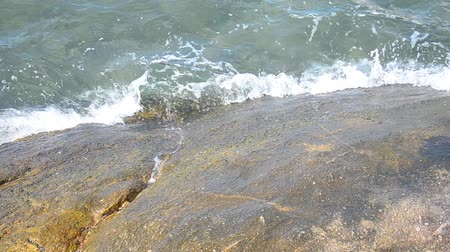 Water wave surf to rock or stone in the sea at Bangsan beach in Chonburi, Thailand Stok Video