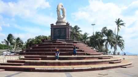 Thai people travel and visit sculpture of dolphins on the waves monument and relaxation at Laem Thaen Cape in Bang Saen Beach in Chonburi, Thailand Dostupné videozáznamy