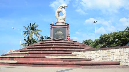 Thai people travel and visit sculpture of dolphins on the waves monument and relaxation at Laem Thaen Cape in Bang Saen Beach in Chonburi, Thailand Stok Video
