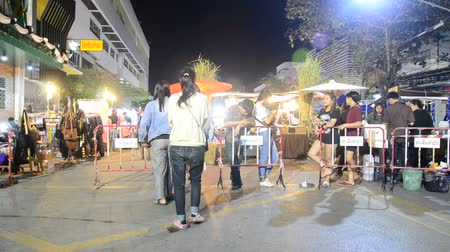 Asian thai people and foreigner travelers walk visit and shopping local product in street night market at Lampang city in Lampang, Thailand Stok Video