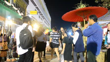 Asian thai people and foreigner travelers walk visit and shopping local product in street night market at Lampang city in Lampang, Thailand 影像素材