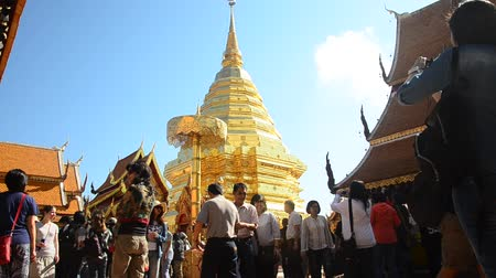 Asian thai people and foreigner respect pray and posing take photo with gold chedi at Wat Phra That Doi Suthep temple in Chiang Mai, Thailand.