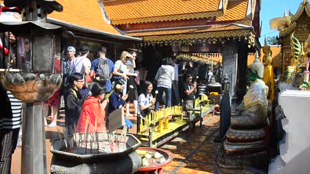 Asian thai people and foriegner respect pray and visit gold chedi of Wat Phra That Doi Suthep at Doi Suthep mountain in Chiang Mai, Thailand.