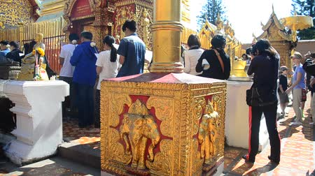 Asian thai people and foreigner respect pray and visit gold chedi of Wat Phra That Doi Suthep at Doi Suthep mountain in Chiang Mai, Thailand.