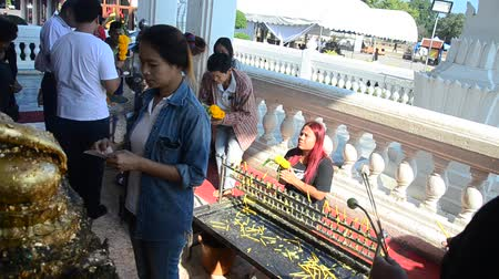 Asian thai people praying and respect with Buddha statue name Luang Pho Phet in ubosot at Wat Tha Luang temple in Phichit, Thailand