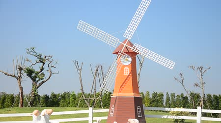 Pin wheel or windmill and decoration of gardening in public garden park for people visit and take photo at Bueng Boraphet in Nakhon sawan, Thailand