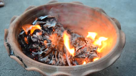 chinees nieuwjaar : People burn joss paper gold and silver paper for worship with paper made to resemble money and burned as sacrificial offering for pray to god and memorial to ancestor in Chinese new year day at house Stockvideo