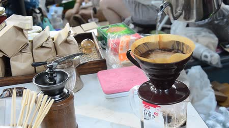 Thai people use drip coffee maker or dripper made hot coffee for show and sale for people at shop in organic market in Nakhon Ratchasima, Thailand