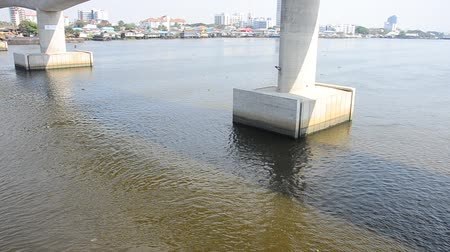 oszlopsor : Wave and flow of water in Chaophraya river at Nonthaburi, Thailand