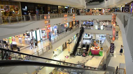Asian thai people walking and use escalator for moving up and down for visit and eat and shopping at shopping mall in Nonthaburi, Thailand