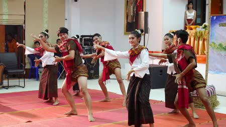 people dancer dancing thai style for show travelers people in traditional culture thai festival at meeting building on in Amnat Charoen, Thailand 影像素材