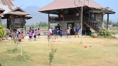 bennszülött : Thai student visit and educational tour at Tai Dam ethnic museum house and playing traditional game of Tai Dam people at Chiang Khan  in Loei, Thailand