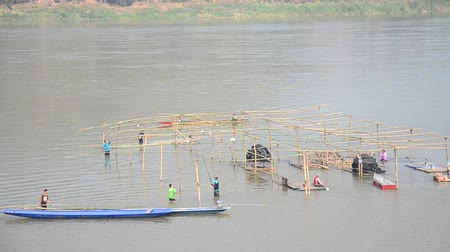 khan : Thai worker people demolition wooden structure of floating restaurant in Mekong river because flood at Kaeng Khut Khu in Chiang Khan city in Loei, Thailand