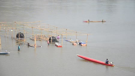 industrial fishing : Thai worker people demolition wooden structure of floating restaurant in Mekong river because flood at Kaeng Khut Khu in Chiang Khan city in Loei, Thailand