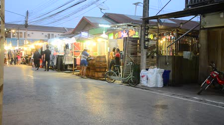 khan : Asian thai people and foreigner travelers visit travel and walking shopping on street night market at Chiang Khan in evening time in Loei, Thailand