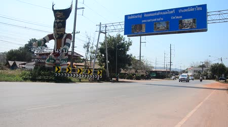 figurka : Big Phi Ta Khon figure symbol of Dan Sai with information board with traffic road at highway in Loei, Thailand.