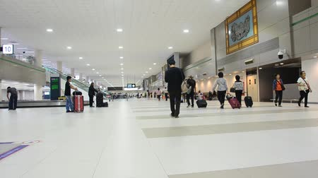 foreigner : Thai people and foreigner traveler wait receive luggage on carousel conveyor and walking at Don Mueang International Airport in Bangkok, Thailand