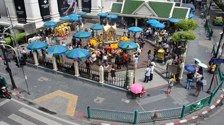 pathum wan : View of the Hindu shrine from BTS Skytrain and Thai and foreigner people praying Thao Maha Phrom or Lord Brahma Great at Erawan Shrine in Bangkok, Thailand