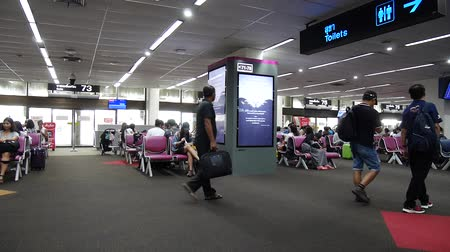 reclamebord : Thai people and foreigner travelers waiting flight at gate and walking inside of Don Mueang international airport in Bangkok, Thailand