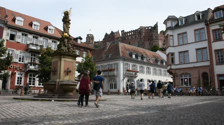 madona : German and foreigner travelers people walking and visit madonna statue at the corn market square or madonna vom kornmarkt in Heidelberg, Germany