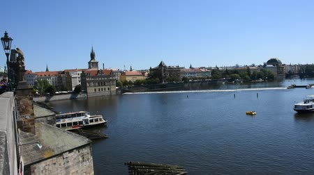prague bridge : River Cruises riding in Vltava river bring passengers traveler visit and look riverside of old town near Charles Bridge in Prague, Czech Republic Stock Footage